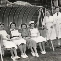 The nurses of Brotton Cottage Hospital trying out the new swing seat presented by the League Of Friends (1953)