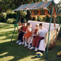 Sara Bayliss children with their cousins on the orginal family swing seat one Summer afternoon (1997)