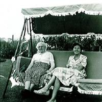 Neil Spreadburys grandmother and great grandmother on the family swing seat (1952)