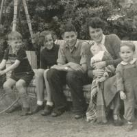 Stephen Hall on the far right, with his mother (Mrs. Nan Hall) who is holding his brother Andrew. The other three children being his cousins Dermot, Anna Mary and Ion Grove-White. Photo taken in 1953 at Ael-y-Don, Bull Bay, Anglesey. The swing seat (extra long) was made to special order for Stephens cousins father John Grove-White for his convalescence after he broke his leg in a motorbike accident